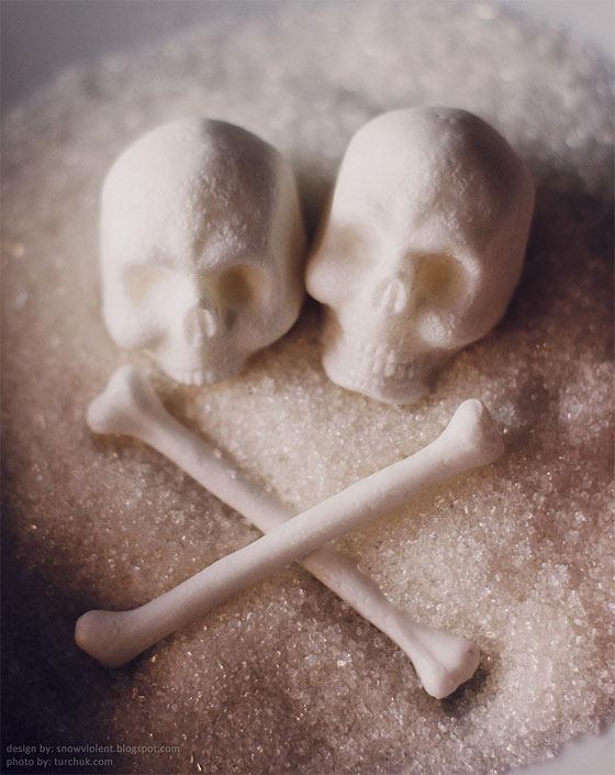 暗い液体に浮かぶ髑髏と骨の形をした角砂糖のコンセプトモデル1