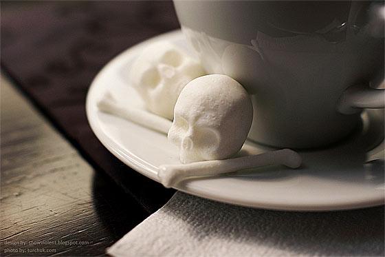 暗い液体に浮かぶ髑髏と骨の形をした角砂糖のコンセプトモデル3